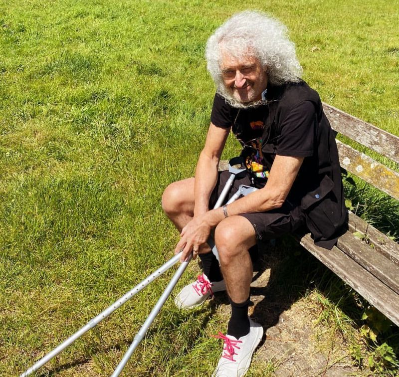 Queen's Brian May around a hospital