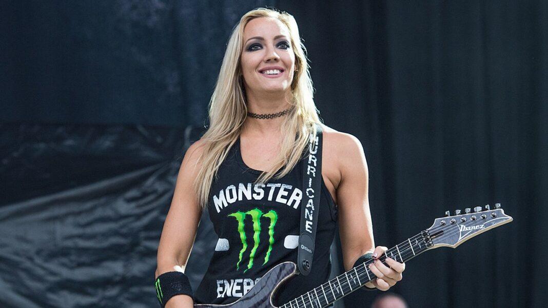 Alice Cooper guitarist Nita Strauss on stage.