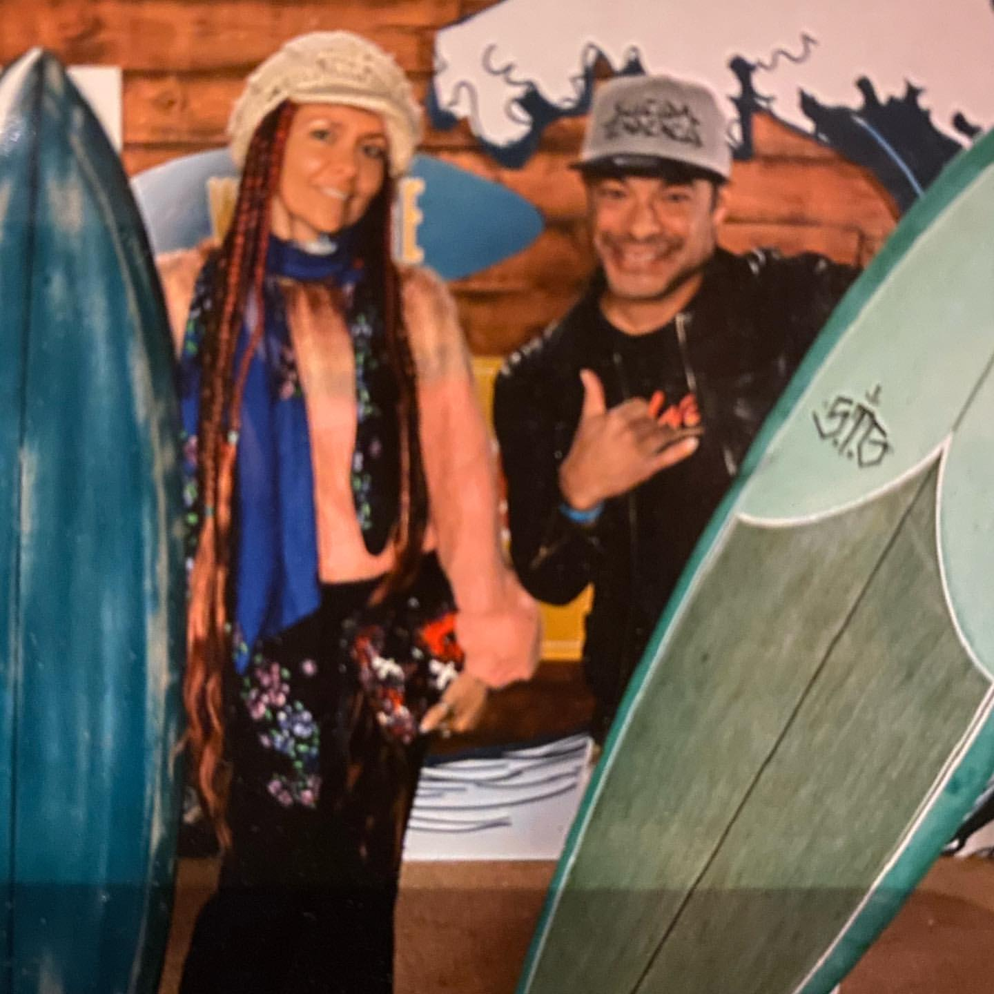 Robert Trujillo and Chloe Trujillo were posing in front of their surfboards.