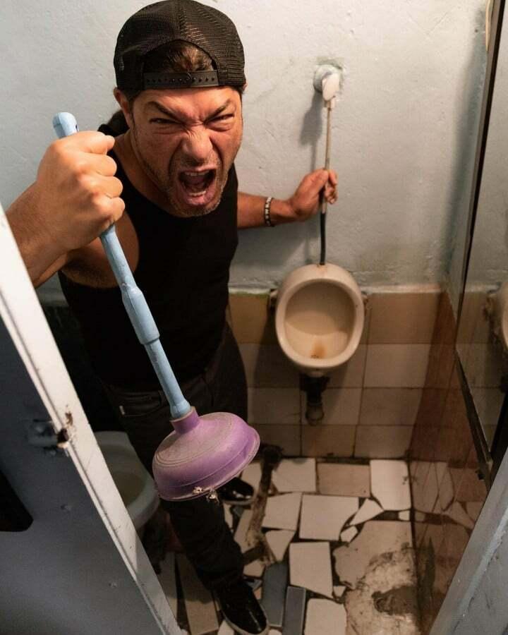 Robert Trujillo with a toilet pump