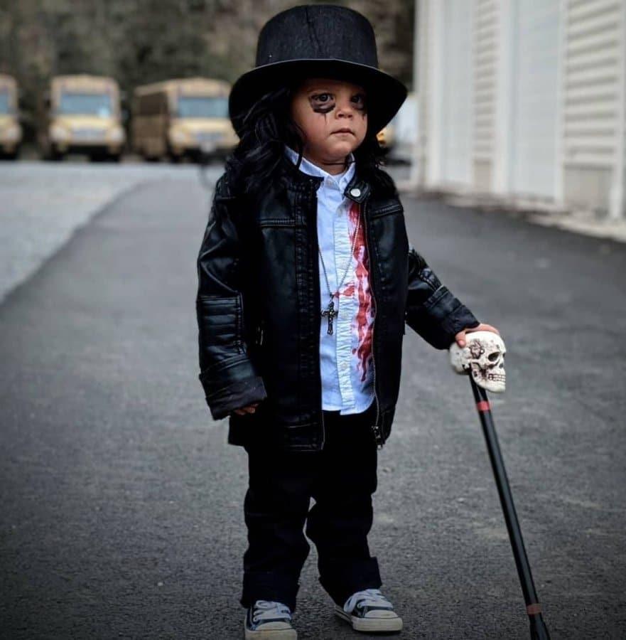 Kid in Alice Cooper Halloween costume